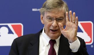 **FILE** Commissioner Bud Selig answers a question during a news conference at Major League Baseball headquarters in New York on May 16, 2013. Major League Baseball hopes to expand video review by umpires for the 2014 season and says all calls other than balls and strikes could be subject to instant replay. (Associated Press)