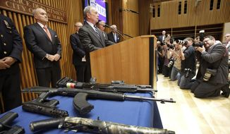 New York Mayor Michael R. Bloomberg (center) and Police Commissioner Raymond Kelly (left) announce on Monday, Aug. 19, 2013, the arrest of 19 people and the seizure of 254 guns as part of gun-smuggling operation between the Carolinas and New York. (AP Photo/Mark Lennihan)