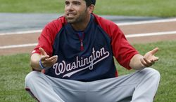 Washington Nationals' David DeJesus talks with new teammate Denard Span after he was traded by the Chicago Cubs to the Nationals before a baseball game between the Cubs and Nationals at Wrigley Field, Monday, Aug. 19, 2013, in Chicago. (AP Photo/Charles Rex Arbogast)