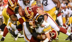 Pittsburgh Steelers quarterback Ben Roethlisberger (7) is sacked in the first quarter as the Washington Redskins play the Pittsburgh Steelers in NFL preseason football at FedEx Field, Landover, Md., Monday, August 19, 2013. (Andrew Harnik/The Washington Times)