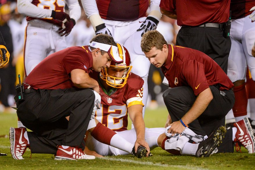 Washington Redskins quarterback Kirk Cousins (12) leaves the game with a foot injury in the second quarter as the Washington Redskins play the Pittsburgh Steelers in NFL preseason football at FedEx Field, Landover, Md., Monday, August 19, 2013. (Andrew Harnik/The Washington Times)