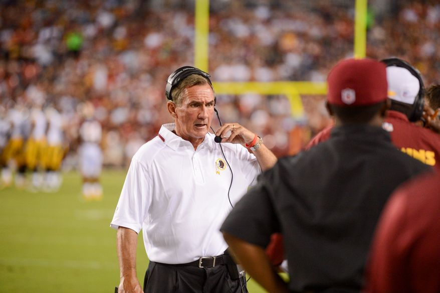 Washington Redskins head coach Mike Shanahan talks to staff on the sideline during the second quarter as the  Washington Redskins play the Pittsburgh Steelers in NFL preseason football at FedEx Field, Landover, Md., Monday, August 19, 2013. (Andrew Harnik/The Washington Times)