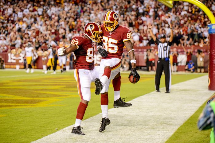 Washington Redskins tight end Fred Davis (83), left, celebrates after Washington Redskins wide receiver Leonard Hankerson (85), right, makes a one handed 10 yard catch for a touchdown in the second quarter as the Washington Redskins play the Pittsburgh Steelers in NFL preseason football at FedEx Field, Landover, Md., Monday, August 19, 2013. (Andrew Harnik/The Washington Times)