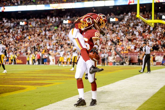 Washington Redskins wide receiver Aldrick Robinson (11), left, celebrates after Washington Redskins wide receiver Leonard Hankerson (85), right, makes a one handed 10 yard catch for a touchdown in the second quarter as the Washin