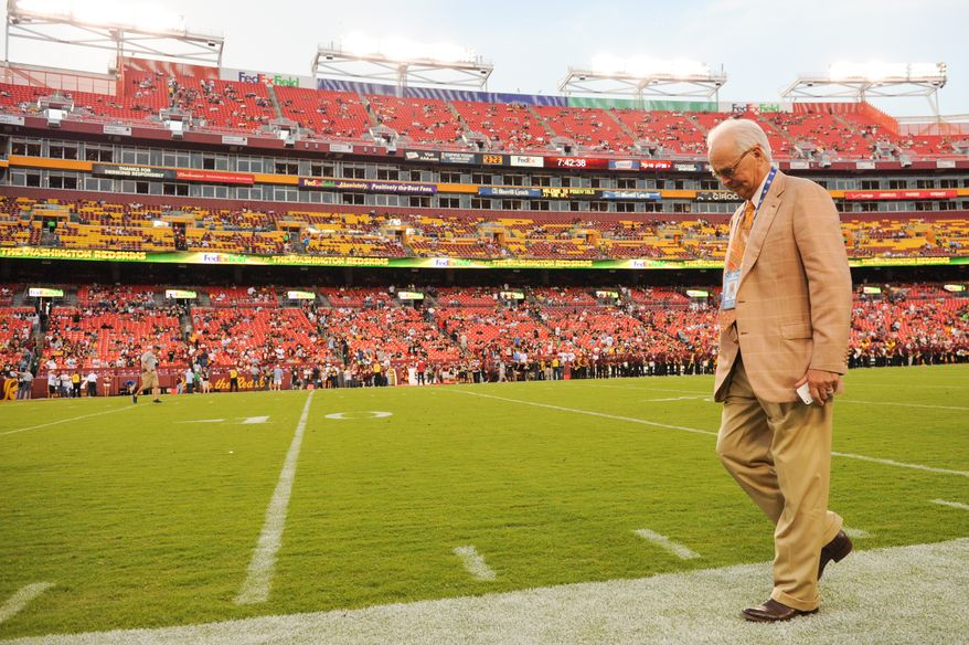 Dr. James Andrews walks along the sideline before the Washington Redskins play the Pittsburgh Steelers in NFL preseason football at FedEx Field, Landover, Md., Monday, August 19, 2013. (Andrew Harnik/The Washington Times)