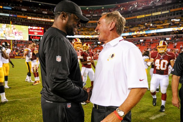 Pittsburgh Steelers head coach Mike Tomlin talks with Washington Redskins head coach Mike Shanahan after the Washington Redskins play the Pittsburgh Steelers in NFL preseason football at FedEx Field, Landover, Md., Monday, August 19, 2013. (Andrew Harnik/The Washington Times)