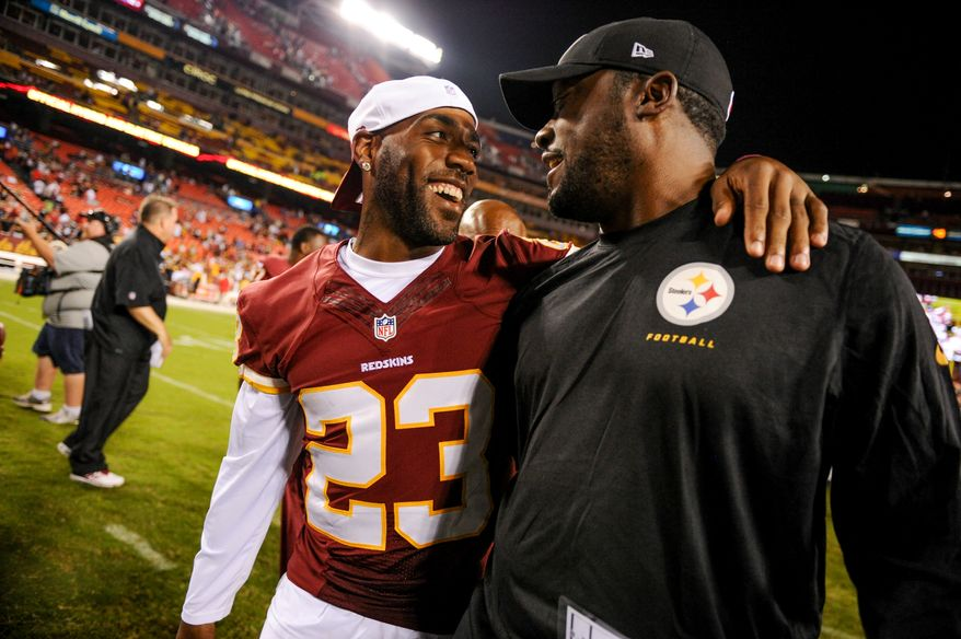 Washington Redskins cornerback DeAngelo Hall (23) talks with Pittsburgh Steelers head coach Mike Tomlin after the Washington Redskins play the Pittsburgh Steelers in NFL preseason football at FedEx Field, Landover, Md., Monday, August 19, 2013. (Andrew Harnik/The Washington Times)