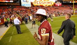 Washington Redskins quarterback Robert Griffin III (10) leaves the field after the Washington Redskins play the Pittsburgh Steelers in NFL preseason football at FedEx Field, Landover, Md., Monday, August 19, 2013. (Andrew Harnik/The Washington Times)