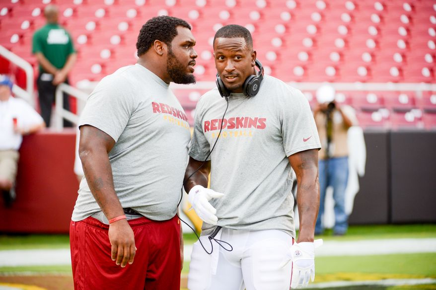 Washington Redskins defensive end Chris Baker (92), left, and Washington Redskins tight end Fred Davis (83), right, talk together before the Washington Redskins play the Pittsburgh Steelers in NFL preseason football at FedEx Field, Landover, Md., Monday, August 19, 2013. (Andrew Harnik/The Washington Times)