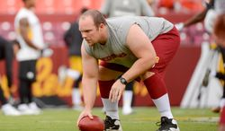 Washington Redskins center Will Montgomery (63) warms up before the Washington Redskins play the Pittsburgh Steelers in NFL preseason football at FedEx Field, Landover, Md., Monday, August 19, 2013. (Andrew Harnik/The Washington Times)