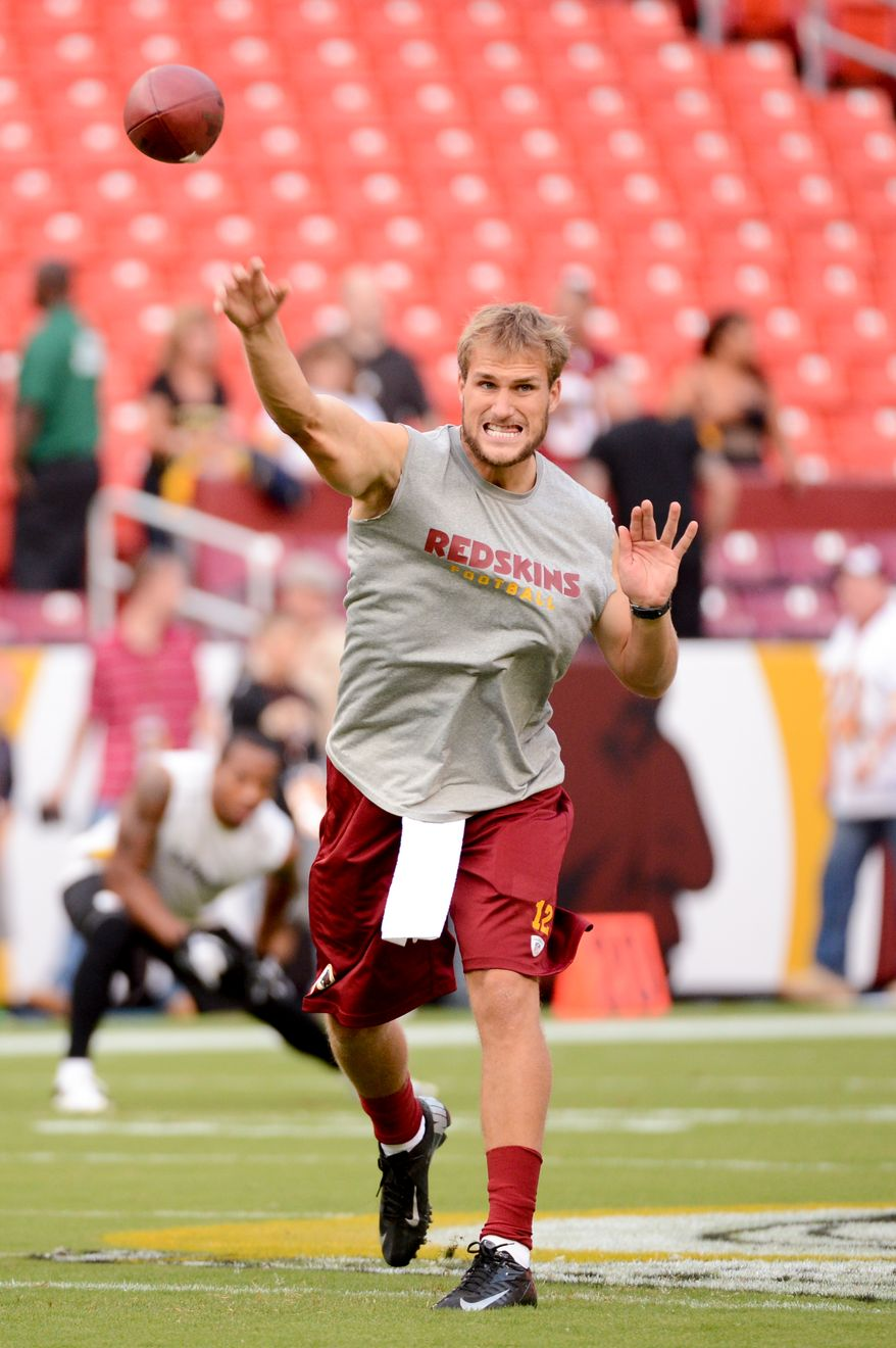 Washington Redskins quarterback Kirk Cousins (12) throws during warm ups before the Washington Redskins play the Pittsburgh Steelers in NFL preseason football at FedEx Field, Landover, Md., Monday, August 19, 2013. (Andrew Harnik/The Washington Times)