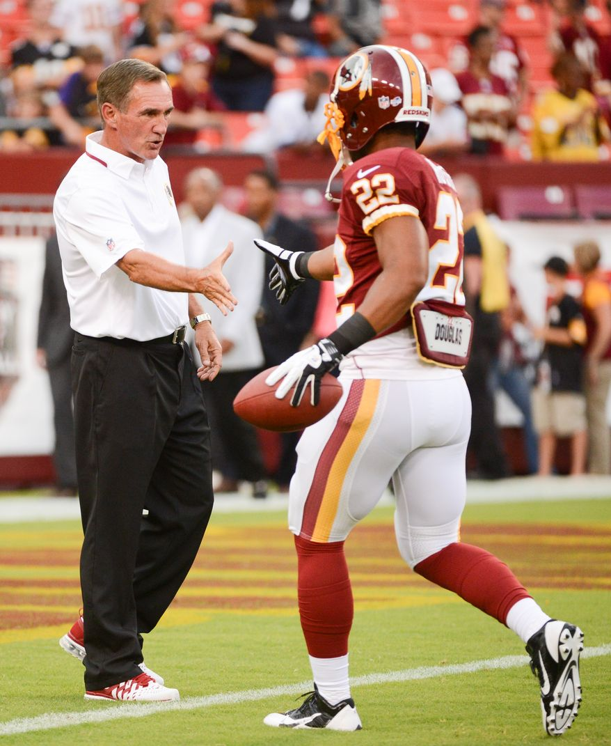 Washington Redskins head coach Mike Shanahan, left, greets Washington Redskins defensive back Jose Gumbs (22) before the Washington Redskins play the Pittsburgh Steelers in NFL preseason football at FedEx Field, Landover, Md., Monday, August 19, 2013. (Andrew Harnik/The Washington Times)