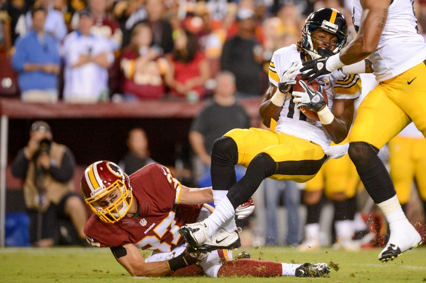 Washington Redskins strong safety Reed Doughty (37) tackles Pittsburgh Steelers wide receiver Markus Wheaton (11) on a punt return in the first quarter as the Washington Redskins play the Pittsburgh Steelers in NFL preseason football at FedEx Field, Landover, Md., Monday, August 19, 2013. (Andrew Harnik/The Washington Times)