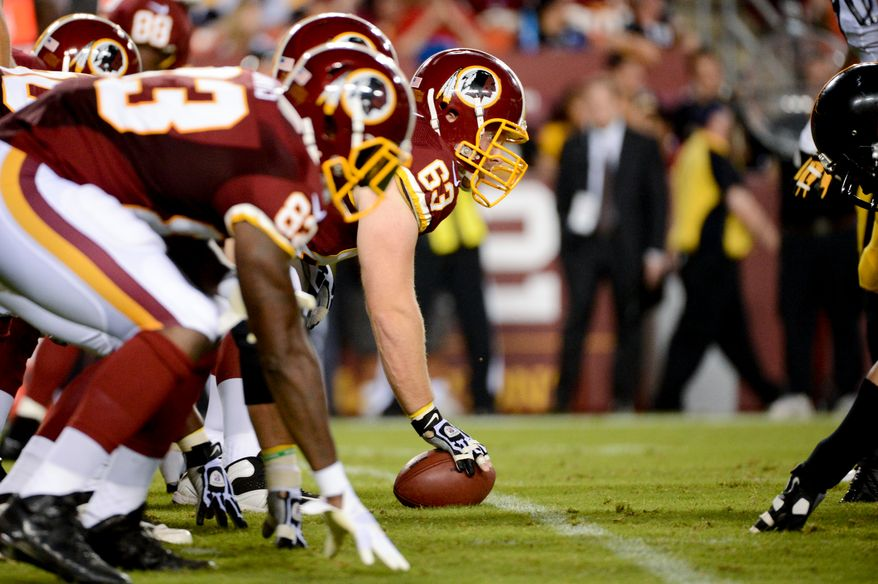 Washington Redskins center Will Montgomery (63) gets ready to snap a ball as the Washington Redskins play the Pittsburgh Steelers in NFL preseason football at FedEx Field, Landover, Md., Monday, August 19, 2013. (Andrew Harnik/The Washington Times)