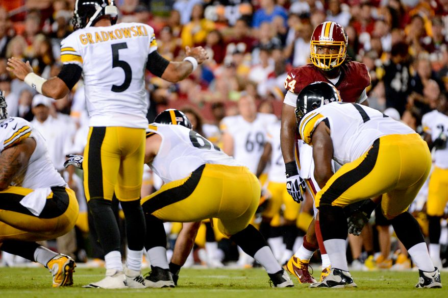 Washington Redskins linebacker Darryl Tapp (54) lines up to rush the quarterback as the Washington Redskins play the Pittsburgh Steelers in NFL preseason football at FedEx Field, Landover, Md., Monday, August 19, 2013. (Andrew Harnik/The Washington Times)
