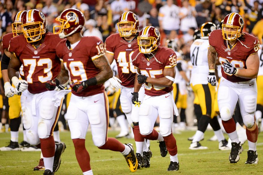 Washington Redskins running back Chris Thompson (35), center, grimaces after hurting his arm as the Washington Redskins play the Pittsburgh Steelers in NFL preseason football at FedEx Field, Landover, Md., Monday, August 19, 2013. (Andrew Harnik/The Washington Times)