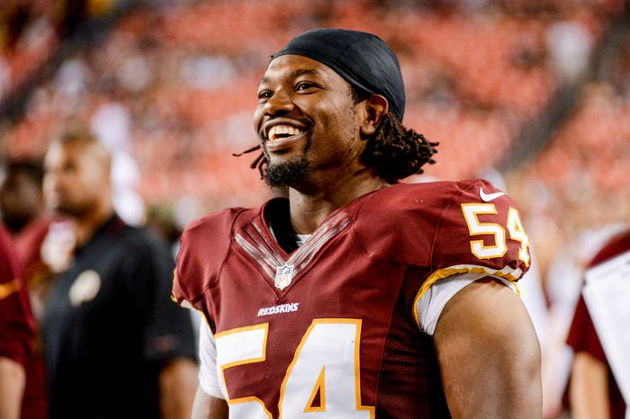 Washington Redskins linebacker Darryl Tapp (54) laughs on the sideline as the Washington Redskins play the Pittsburgh Steelers in NFL preseason football at F