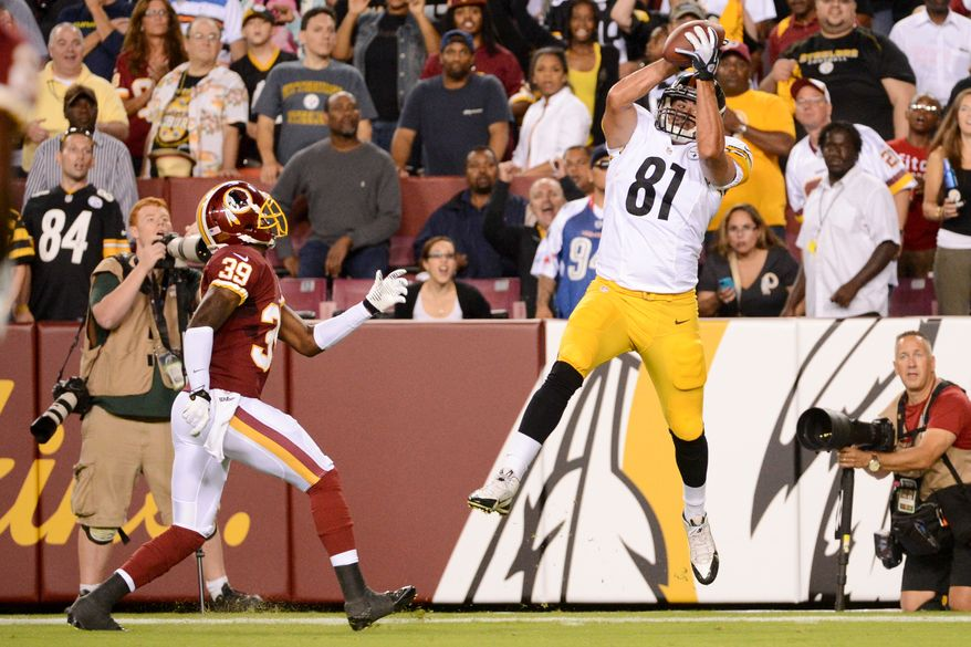 Washington Redskins cornerback David Amerson (39), left, watches as Pittsburgh Steelers tight end Michael Palmer (81) makes a catch as the Washington Redskins play the Pittsburgh Steelers in NFL preseason football at FedEx Field, Landover, Md., Monday, August 19, 2013. (Andrew Harnik/The Washington Times)