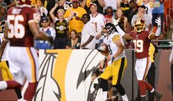 Washington Redskins cornerback David Amerson (39), right, shows frustration after Pittsburgh Steelers tight end Michael Palmer (81) makes a catch as the Washington Redskins play the Pittsburgh Steelers in NFL preseason football at FedEx Field, Landover, Md., Monday, August 19, 2013. (Andrew Harnik/The Washington Times)