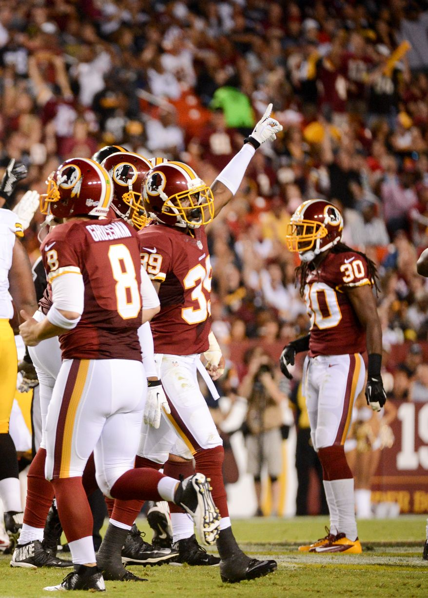 Washington Redskins cornerback David Amerson (39), center, celebrates after a play as the Washington Redskins play the Pittsburgh Steelers in NFL preseason football at FedEx Field, Landover, Md., Monday, August 19, 2013. (Andrew Harnik/The Washington Times)