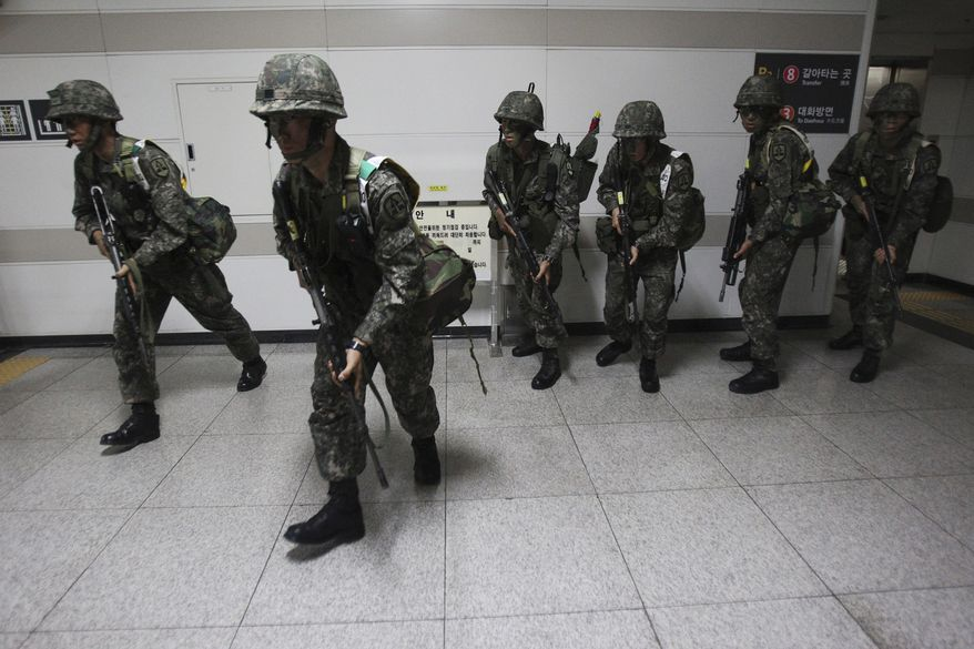 """South Korean army soldiers take part in South Korea-U.S. joint military exercise, """"Ulchi Focus Lens,"""" at a subway station in Seoul on Aug. 19, 2013. South Korea and the United States are conducting the annual military drills. (Associated Press)"""
