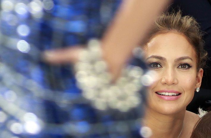 Jennifer Lopez watches a fashion show in Paris in this 2012 photo. (AP Photo/Thibault Camus, File)