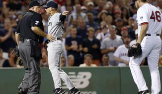 New York Yankees manager Joe Girardi, center, points at Boston Red Sox's Ryan Dempster (46) while arguing with home plate umpire Brian O'Nora after Dempster hit Yankees Alex Rodriguez with a pitch in the second inning of a baseball game in Boston, Sunday, Aug. 18, 2013. (AP Photo/Michael Dwyer)