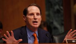 """Sen. Ron Wyden, Oregon Democrat, said the National Security Agency """"has knowingly acquired tens of thousands of wholly domestic communications  even though this law was specifically written to prohibit the warrantless acquisition of wholly domestic communications."""" (ASSOCIATED PRESS)"""
