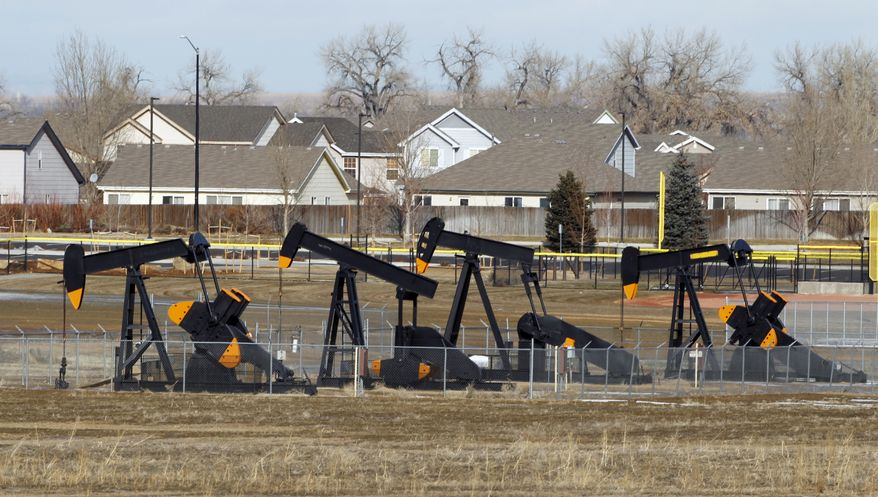 **FILE** Four oil pumps near a subdivision near Frederick, Colo., are seen here on Jan. 18, 2012. Oil and gas drilling in Colorado is no longer confined to the state's most rural areas. Energy companies are moving to drill in populous Front Range communities prompting local planners to suggest regulations that energy companies complaints far exceed county authority. Politicians from both parties are calling for legislation clarifying that locals can't set their own rules when it comes to drilling. (Associated Press)