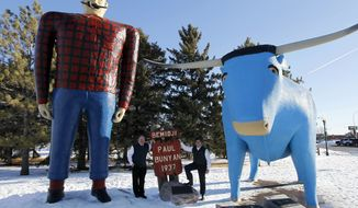 "**FILE** Republican presidential candidate and former Pennsylvania Sen. Rick Santorum (right) stands below the Paul Bunyan and Babe the Blue Ox statues with Bill Batchhelder during a campaign stop in Bemidji, Minn., on Feb. 5, 2012. Bachhelder's company, Bemidji Woolen Mills, manufactures the official ""Santorum for President"" sweater vest. (Associated Press)"