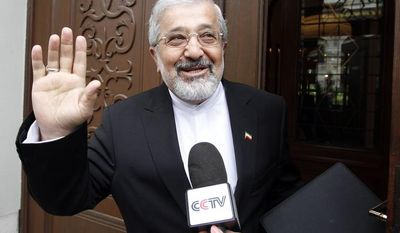 **FILE** Ali Asghar Soltanieh, Iran's Ambassador to the International Atomic Energy Agency (IAEA), waves May 14, 2012, as he arrives for talks with the IAEA at the permanent mission of Iran in Vienna. (Associated Press)
