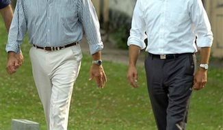 ** FILE ** Delaware Attorney General Beau Biden, right, takes a walk with his father,Vice President Joe Biden, to the Green Ridge Little Baseball Field in Scranton, Pa, July 4, 2012. Beau Biden is being evaluated at a cancer center in Texas, according to people with knowledge of his condition. (AP Photo/The Scranton Times-Tribune, Butch Comegys)