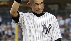 New York Yankees' Ichiro Suzuki tips his helmet after connecting for his 4,000th career hit in Japan and the major leagues, in the first inning of a baseball game against the Toronto Blue Jays at Yankee Stadium, Wednesday, Aug. 21, 2013, in New York. (AP Photo/Kathy Willens)