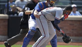 Atlanta Braves' Jason Heyward, right, is helped by New York Mets catcher John Buck, center, and umpire Greg Gibson after being hit by a pitch thrown by New York Mets' Jonathon Niese during the sixth inning of the baseball game at Citi Field Wednesday, Aug. 21, 2013 in New York. (AP Photo/Seth Wenig)
