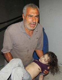 This citizen journalism image provided by the Local Committee of Arbeen, authenticated based on its contents and other AP reporting, shows a Syrian man reacts as he carries a dead body of a Syrian girl after an alleged poisonous gas attack fired by regime forces, according to activists in Arbeen town of Damascus on Aug. 21, 2013. Syrian anti-government activists accused the regime of carrying out a toxic gas attack that killed at least 100 people, including many children as they slept, during intense artillery and rocket barrages on the eastern suburbs of Damascus, part of a fierce government offensive in the area. (Associated Press/Local Committee of Arbeen)