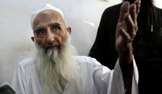 Pakistani cleric Haji Alam Sher, founder of the Jamia Taleem-Ul-Quran-Wal-Hadith Madrassa, talks to the media in Peshawar, Pakistan, on Wednesday, Aug. 21, 2013. The United States has placed unprecedented sanctions on the Islamic school for allegedly training and financing fighters from al Qaeda and other militant groups. (AP Photo/Mohammad Sajjad)