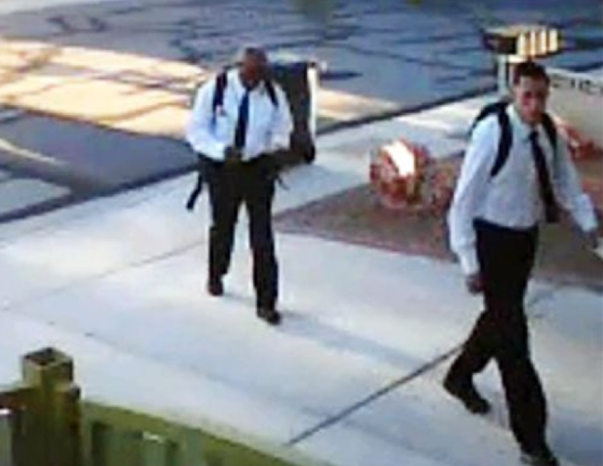 Home surveillance video shows two suspects who reportedly dressed as Mormon missionaries and asked a man to talk about religion before allegedly robbing him at gunpoint on Thursday, June 27, 2013, in Las Vegas. Police say the victim spoke with the men for about five minutes before they jumped him, punched him and stole property. (AP Photo/Las Vegas Metropolitan Police Department)