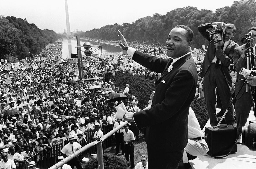 """Martin Luther King Jr. waves to supporters on Aug. 28, 1963, in what he called """"the greatest demonstration of freedom in the history of the United States."""" Martin Luther King was assassinated on 04 April 1968 in Memphis, Tennessee. James Earl Ray confessed to shooting King and was sentenced to 99 years in prison. King's killing sent shock waves through American society at the time, and is still regarded as a landmark event in recent US history. AFP PHOTO (Photo credit should read -/AFP/Getty Images) (Agence France-Presse/Getty Images)"""