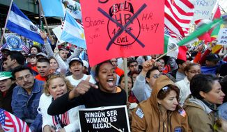 **FILE** Wendy Irving (center), a legal resident from Jamaica living in the Bronx borough of New York, shouts slogans during a rally against immigration reform held in front of New York's City Hall on April 10, 2006. (Associated Press)