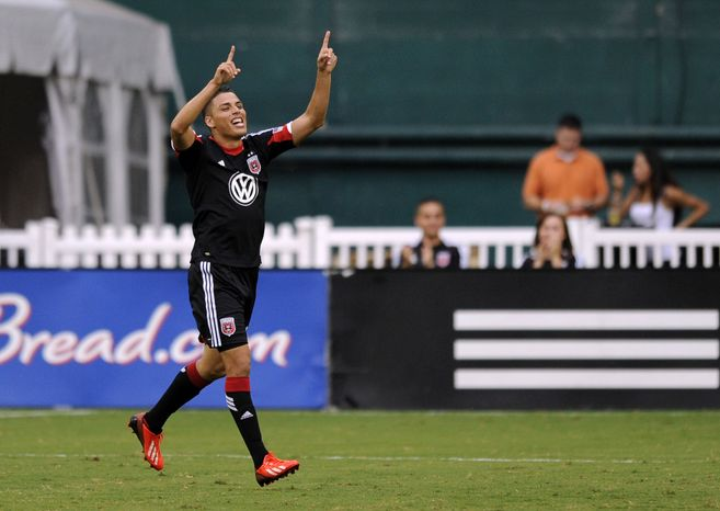 D.C. United midfielder Luis Silva celebrates his goal during the first half of an MLS soccer game against the New England Revolution, Saturday, July 27, 2013, in Washington. (AP Photo/Nick Wass)