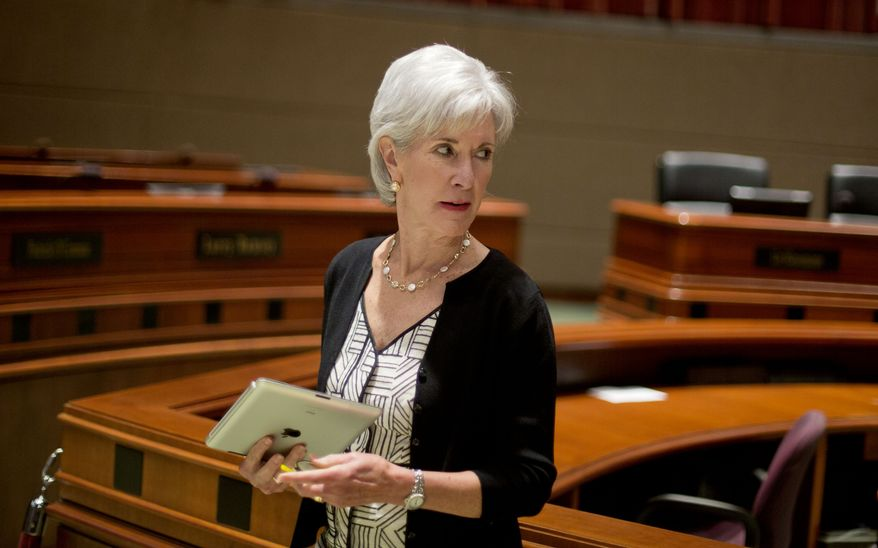 ** FILE ** Kathleen Sebelius, secretary of health and human services, leaves the podium after discussing the Affordable Care Act at a news conference in Atlanta on Tuesday, Aug. 13, 2013. (AP Photo/David Goldman)