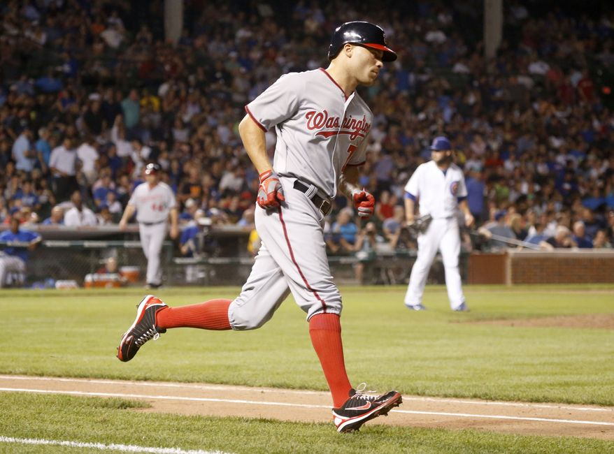 Washington Nationals outfielder Scott Hairston rounds the bases after hitting a pinch-hit three-run homer in the seventh inning Wednesday night. (Associated Press photo)