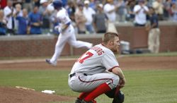 Washington Nationals starting pitcher Stephen Strasburg reacts after giving up the game-tying two-run home run to Chicago Cubs' Donnie Murphy, background, during the ninth inning of a baseball game Thursday, Aug. 22, 2013, in Chicago. (AP Photo/Charles Rex Arbogast)