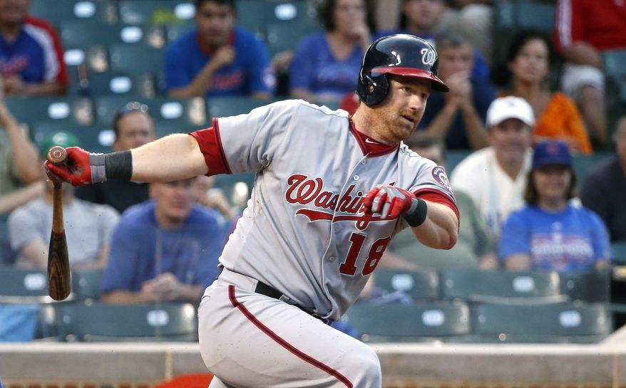 Washington Nationals pinch-hitter Chad Tracy hits an RBI-fielder's choice off Chicago Cubs relief pitcher Michael Bowden during the 13th inning of a baseball game on Thursday, Aug. 22, 2013, in Chicago. (AP Photo/Charles Rex Arbogast)