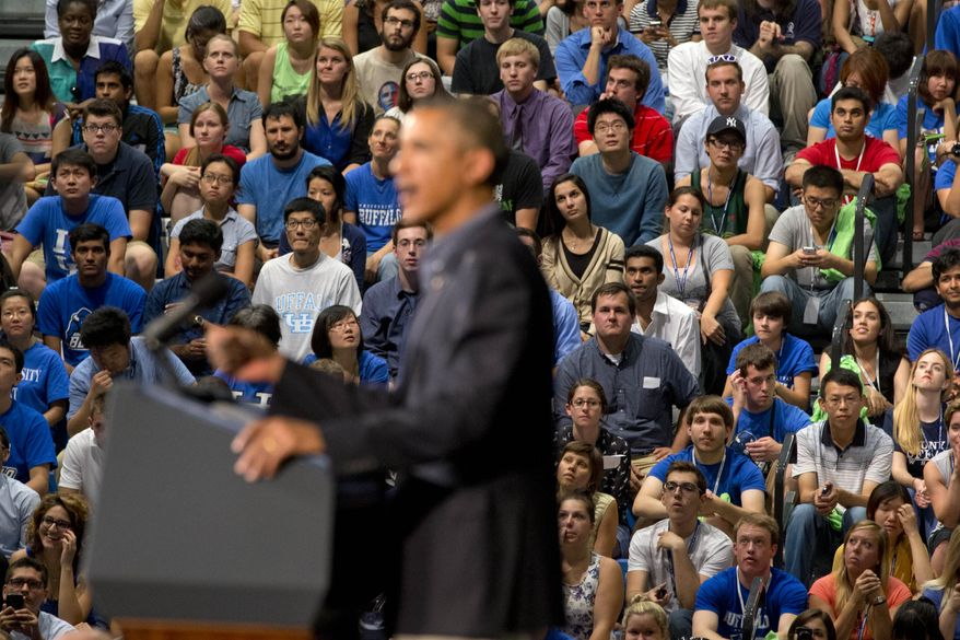 Students listen as President Obama speaks at the University at Buffalo in Buffalo, N.Y., on Thursday, Aug. 22, 2013, at the beginning of a two-day bus tour. (AP Photo/Jacquelyn Martin)