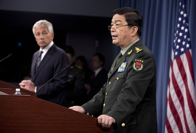 Defense Secretary Chuck Hagel (left) listens Gen. Chang Wanquan, China's defense minister, speaks during their joint news conference at th