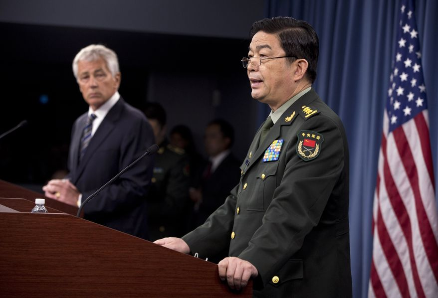 Defense Secretary Chuck Hagel (left) listens Gen. Chang Wanquan, China's defense minister, speaks during their joint news conference at the Pentagon on Monday, Aug. 19, 2013. (AP Photo/Evan Vucci)