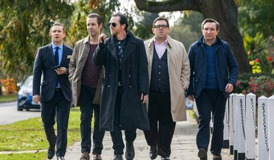 "From left: Martin Freeman, Paddy Considine, Simon Pegg, Nick Frost, and Eddie Marsan star in ""The World's End,"" which tells the story about old friends reliving a night on the town. (Focus Features via Associated Press)"