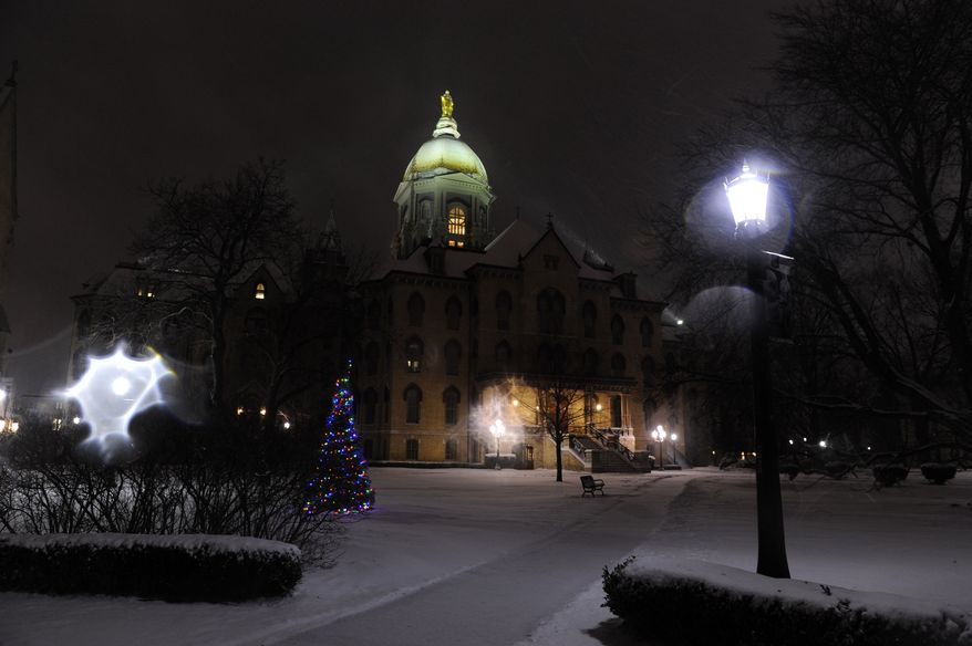 ** FILE ** The Golden Dome on the campus of the University of Notre Dame outside South Bend, Ind., is pictured on Dec. 26, 2012. (Associated Press)