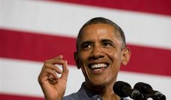 President Obama speaks about college financial aid at Henninger High School in Syracuse, N.Y., Thursday, Aug. 22, 2013, on the first day of a two day bus tour. (AP Photo/Jacquelyn Martin)